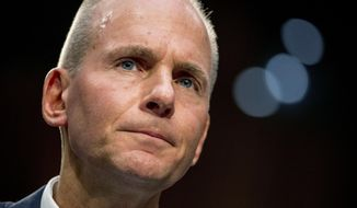 """In this Oct. 29, 2019, file photo Boeing Company President and Chief Executive Officer Dennis Muilenburg appears before a Senate Committee on Commerce, Science, and Transportation hearing on """"Aviation Safety and the Future of Boeing's 737 MAX"""" on Capitol Hill in Washington. (AP Photo/Andrew Harnik, File)"""