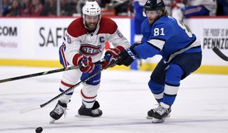 Winnipeg Jets' Kyle Connor (81) and Montreal Canadiens' Shea Weber (6) battle for the puck during second period NHL hockey action in Winnipeg, Manitoba on Monday Dec. 23, 2019. (Fred Greenslade/The Canadian Press via AP)