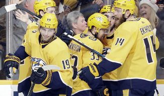 Nashville Predators right wing Viktor Arvidsson (33), of Sweden, celebrates with teammates after scoring a goal against the Arizona Coyotes during the second period of an NHL hockey game Monday, Dec. 23, 2019, in Nashville, Tenn. (AP Photo/Mark Humphrey)