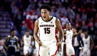 Georgia's Sahvir Wheeler (15) celebrates during the team's NCAA college basketball game against Georgia Southern on Monday, Dec. 23, 2019, in Athens, Ga. (Casey Sykes/Athens Banner-Herald via AP)
