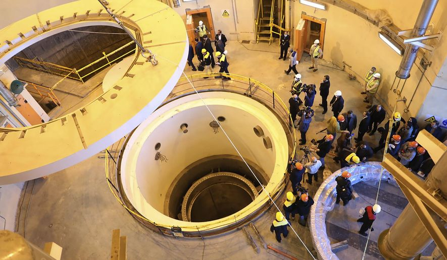 In this photo released by the Atomic Energy Organization of Iran, technicians work at the Arak heavy water reactor's secondary circuit, as officials and media visit the site, near Arak, 150 miles (250 kilometers) southwest of the capital Tehran, Iran, Monday, Dec. 23, 2019. The head of Iran's nuclear agency says his country has begun new operations at the  heavy water nuclear reactor. The move intensifies pressure on Europe to find an effective way around U.S. sanctions, which block Tehran's oil sales abroad. (Atomic Energy Organization of Iran via AP)