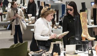 """This Tuesday, Nov. 26, 2019, file photo shows customers shopping in the shoe department at the Nordstrom NYC Flagship in New York. """"Clearly, shopping is much more about an experience,"""" said Jamie Nordstrom, president of Nordstrom stores and the great-grandson of the company's founder. """"It's not just about getting through their lists. They want to bump into something new, something they didn't come into find. I think great stores do that well."""" (AP Photo/Mary Altaffer)"""