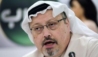 In this Dec. 15, 2014, file photo, Saudi journalist Jamal Khashoggi speaks during a news conference in Manama, Bahrain. A court in Saudi Arabia on Monday sentenced five people to death for the killing of Washington Post columnist Khashoggi, who was murdered in the Saudi Consulate in Istanbul last year by a team of Saudi agents. (AP Photo/Hasan Jamali, File)