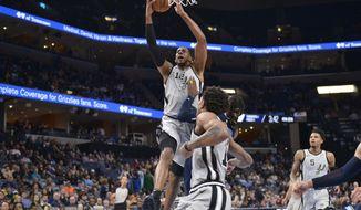 San Antonio Spurs center LaMarcus Aldridge (12) shoots next to Memphis Grizzlies forward Jae Crowder during the second half of an NBA basketball game Monday, Dec. 23, 2019, in Memphis, Tenn. (AP Photo/Brandon Dill)