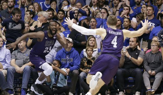 In this Nov. 26, 2019, file photo, Stephen F. Austin forward Nathan Bain (23) and guard David Kachelries (4) celebrate Bain's game-winning basket against Duke in overtime of an NCAA college basketball game in Durham, N.C. (AP Photo/Gerry Broome, File)  **FILE**