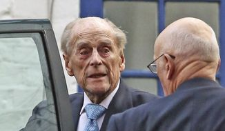 Britain's Prince Philip leaves King Edward VII Hospital in London, Tuesday, Dec. 24, 2019. Prince Philip left the hospital Tuesday after being treated for what Buckingham Palace called a pre-existing condition.The 98-year-old is expected to join the rest of Britain's royal family for Christmas at Sandringham House in eastern England. (Philip Toscano/PA via AP)