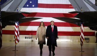 In this Dec. 20, 2019, file photo, President Donald Trump arrives with first lady Melania Trump to sign the National Defense Authorization Act for Fiscal Year 2020 at Andrews Air Force Base, Md. Melania Trump is quietly forging her way through President Donald Trump's impeachment. (AP Photo/Andrew Harnik, File)