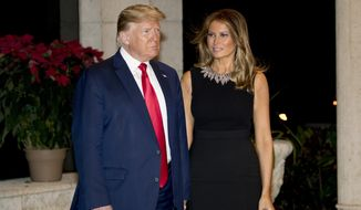 President Donald Trump and first lady Melania Trump arrive for Christmas Eve dinner at Mar-a-lago in Palm Beach, Fla., Tuesday, Dec. 24, 2019. (AP Photo/Andrew Harnik)