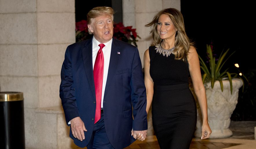 President Donald Trump and first lady Melania Trump arrive for Christmas Eve dinner at Mar-a-Lago in Palm Beach, Fla., Tuesday, Dec. 24, 2019. (AP Photo/Andrew Harnik) ** FILE **