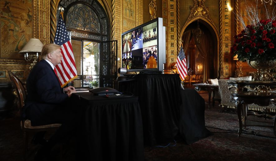 President Donald Trump speaks during a Christmas Eve video teleconference with members of the military at his Mar-a-Lago estate in Palm Beach, Fla., Tuesday, Dec. 24, 2019. (AP Photo/Andrew Harnik)
