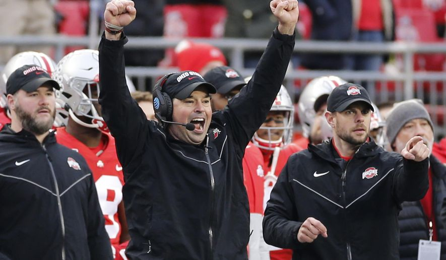 In this Nov. 23, 2019, file photo, Ohio State head coach Ryan Day celebrates on the sideline during an NCAA college football game against Penn State in Columbus, Ohio.  A year ago, Day was a relatively unknown Ohio State assistant. This December he's reigning Big Ten coach of the year and is eyeing a national title after leading the Buckeyes to a 13-0 record as the successor to the retiring Urban Meyer. (AP Photo/Jay LaPrete, File)  **FILE**