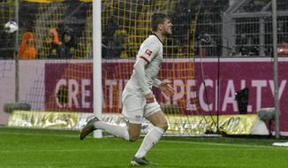 Leipzig's Timo Werner celebrates after scoring during the German Bundesliga soccer match between Borussia Dortmund and RB Leipzig in Dortmund, Germany, Tuesday, Dec. 17, 2019. Th match ended 3-3. (AP Photo/Martin Meissner)