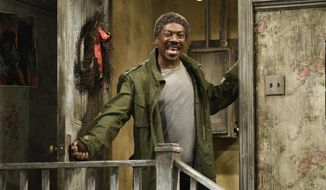 "This Dec. 21, 2019 photo shows Eddie Murphy in a sketch from ""Mr. Robinson's Neighborhood"" on ""Saturday Night Live"" in New York.  (Will Heath/NBC via AP)"