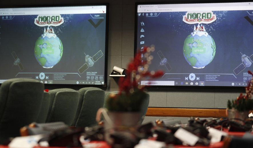 Monitors are illuminated in the NORAD Tracks Santa center at Peterson Air Force Base, Monday, Dec. 23, 2019, in Colorado Springs, Colo. More than 1,500 volunteers will answer an estimated 140,000 telephone calls from childfren and their parents who will be checking on the whereabouts of Santa Clau on Christmas Eve. (AP Photo/David Zalubowski)