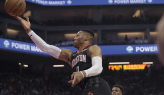 Houston Rockets guard Russell Westbrook (0) lays the ball up during the first quarter of the team's NBA basketball game against the Sacramento Kings in Sacramento, Calif., Monday, Dec. 23, 2019. (AP Photo/Randall Benton)
