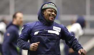 Seattle Seahawks running back Marshawn Lynch runs through warmups at the NFL football team's practice facility Tuesday, Dec. 24, 2019, in Renton, Wash. When Lynch played his last game for the Seahawks in 2016, the idea of him ever wearing a Seahawks uniform again seemed preposterous. Yet, here are the Seahawks getting ready to have Lynch potentially play a major role on Sunday against San Francisco with the NFC West title on the line. (AP Photo/Elaine Thompson)