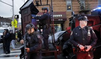 FILE - In this Dec. 10, 2019 photo, emergency responders move heavy equipment near the scene of a shooting in Jersey City, N.J. Authorities say six people, including a police officer and three bystanders, have been killed in a furious gun battle that filled the streets of Jersey City, New Jersey, with the sound of heavy gunfire for hours. The dead include two suspects.  The shooting was one of the top news stories in New Jersey in 2019. (AP Photo/Seth Wenig, File)