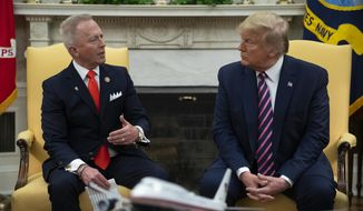 In this Dec. 19, 2019 photo, President Donald Trump meets with Rep. Jeff Van Drew, D-N.J., who is planning to switch his party affiliation, in the Oval Office of the White House in Washington.  Drew changing his party was one of the top news stories in New Jersey in 2019. (AP Photo/ Evan Vucci, File) **FILE**