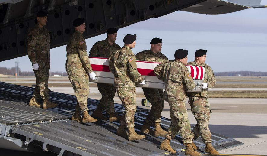 An Army carry team moves a transfer case containing the remains of U.S. Army Sgt. 1st Class Michael Goble, Wednesday, Dec. 25, 2019, at Dover Air Force Base, Del. According to the Department of Defense, Goble, of Washington Township, N.J., assigned to the 7th Special Forces Group, died while supporting Operation Freedom's Sentinel. (AP Photo/Alex Brandon)