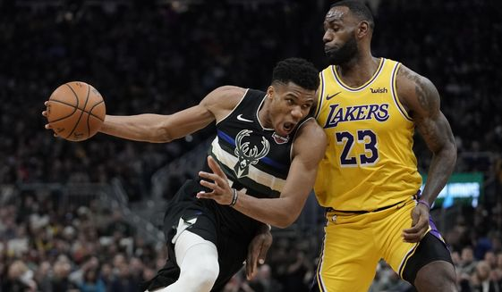 Milwaukee Bucks' Giannis Antetokounmpo tries to drive past Los Angeles Lakers' LeBron James during the second half of an NBA basketball game Thursday, Dec. 19, 2019, in Milwaukee. The Bucks won 111-104. (AP Photo/Morry Gash) ** FILE **