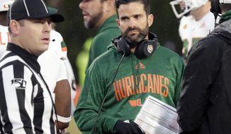 Miami head coach Manny Diaz looks to an official during the second quarter of an NCAA college football game against Duke in Durham, N.C., Saturday, Nov. 30, 2019. (AP Photo/Chris Seward)