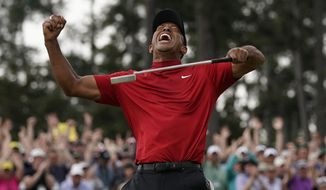 FILE - In this April 14, 2019 file photo, Tiger Woods reacts as he wins the Masters golf tournament in Augusta, Ga. Woods' victory at the Masters might not have been the most important sports story of 2019. It was certainly one of the most uplifting. Voters chose Woods' dramatic comeback at Augusta National as The Associated Press sports story of the year.  (AP Photo/David J. Phillip, File)