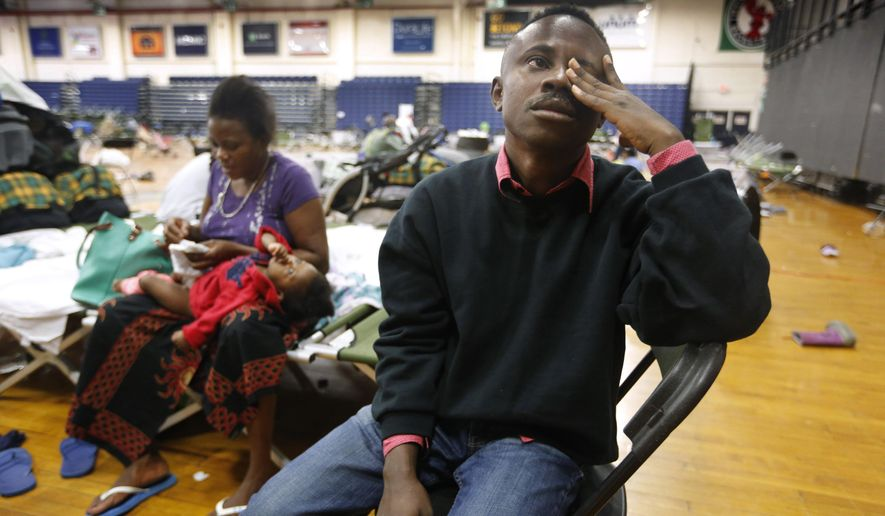 In this Aug. 15, 2019, file photo, Thierry Malasa pauses while describing the harrowing journey that led his family from the Congo to Maine, as the family prepared to move out of the Portland Expo, in Portland, Maine. The state's largest city raced to find homes for dozens of African asylum seekers as the temporary shelter closed. On Jan. 2, 2020, a Maine developer came forward with plans to use a former monastery to house newly arrived asylum seekers. (AP Photo/Robert F. Bukaty, File) **FILE**
