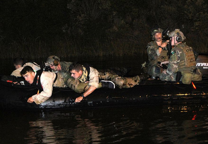 Marine Raiders navigate a Combat Rubber Raid Craft during a nighttime Visit, Board, Search and Seizure preparation near Mobile, Alabama. The VBSS was part of a 10-day exercise in the Gulf Coast region to maintain unit readiness.  (U. S. Marine Corps photo by Gunnery Sgt. Joshua S. Higgins/Released)