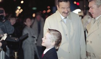 """Actor Walter Matthau taps Macaulay Culkin under the chin as they pause for photographers before a screening of Culkin's new film """"Home Alone 2: Lost in New York,"""" Nov. 14, 1992, in Chicago.  Matthau is in Chicago filming """"Dennis the Menace.""""  (AP Photo/Mike Fisher)"""