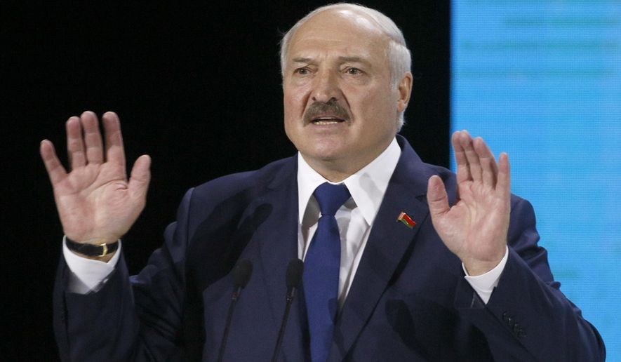 In this file photo taken on Friday, Oct. 4, 2019, Belarusian President Alexander Lukashenko speaks during Ukraine Belarus forum in Zhytomyr, Ukraine. The president of Belarus warned Russia on Tuesday, Dec. 24, 2019 against a forced merger of the two ex-Soviet neighbors, saying such a move by Moscow could trigger a war. (AP Photo/Efrem Lukatsky, File)