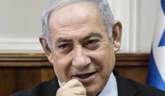 Israeli Prime Minister Benjamin Netanyahu chairs the weekly cabinet meeting at the Prime Minister's office in Jerusalem, Sunday, Dec. 22, 2019. (AP Photo/Tsafrir Abayov, Pool)