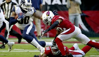 Los Angeles Rams running back Todd Gurley (30) is tackled by Arizona Cardinals middle linebacker Jordan Hicks (58) and strong safety Budda Baker during the first half of an NFL football game, Sunday, Dec. 1, 2019, in Glendale, Ariz. (AP Photo/Rick Scuteri)