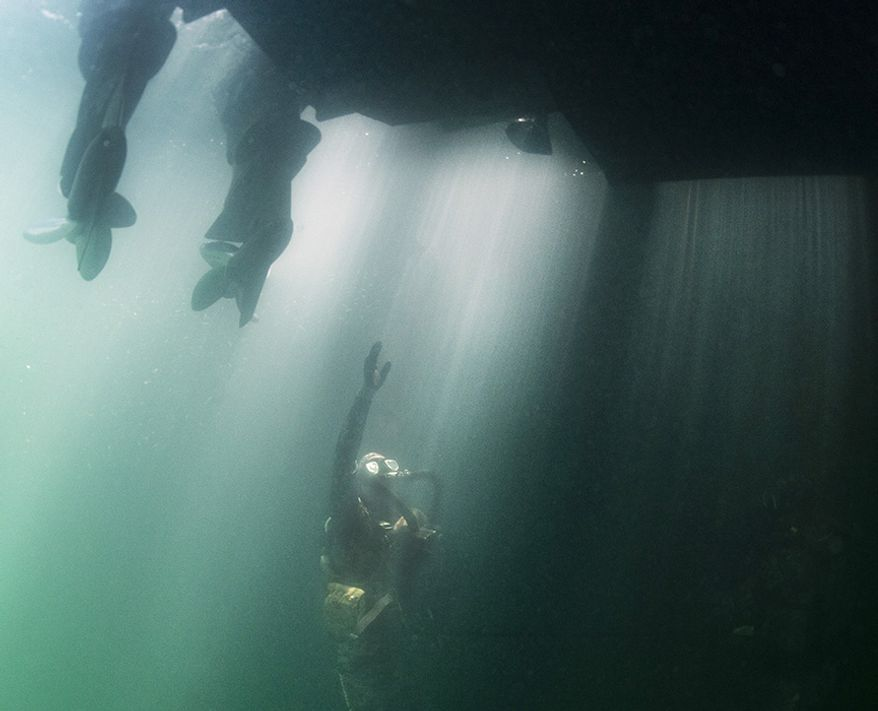 A Sailor assigned to Naval Special Warfare Group 2 conducts military dive operations off the East Coast of the United States. U.S. Navy SEALs engage in a continuous training cycle to improve and further specialize skills needed during deployments across the globe. SEALs are the maritime component of U.S. Special Forces and are trained to conduct missions from sea, air, and land. Naval Special Warfare (NSW) has more than 1,000 special operators and support personnel deployed to more than 35 countries, addressing security threats, assuring partners and strengthening alliances while supporting Joint and combined campaigns. (U.S. Navy photo by Senior Chief Mass Communication Specialist Jayme Pastoric/Released)190529-N-XD935-006