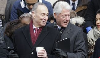 Former President Bill Clinton and Sen. Charles Schumer arrive before New York City Mayor-elect Bill de Blasio takes the oath of office in on the steps of City Hall on Wednesday, Jan. 1, 2014, in New York. (AP Photo/Frank Franklin II) **FILE**
