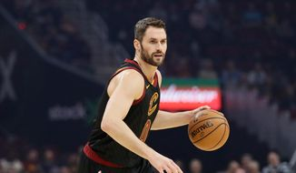 Cleveland Cavaliers' Kevin Love drives against the Charlotte Hornets in the first half of an NBA basketball game, Wednesday, Dec. 18, 2019, in Cleveland. (AP Photo/Tony Dejak) ** FILE **