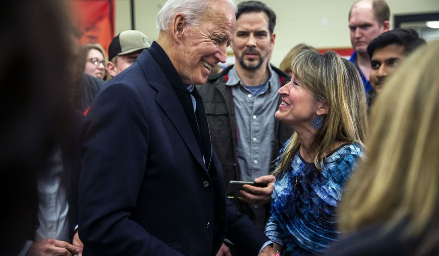 Democratic presidential candidate former Vice President Joe Biden greets people after taking questions at Williamsburg High School, Friday, Dec. 27, 2019 in Williamsburg, Iowa. (Kelsey Kremer/The Des Moines Register via AP)  ** FILE **