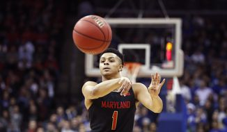 Maryland guard Anthony Cowan Jr. (1). passes during the first half of an NCAA college basketball game, Thursday, Dec. 19, 2019, in Newark, N.J. (AP Photo/Kathy Willens) ** FILE **