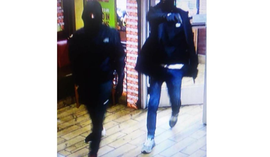 This photo released by the FBI on Dec. 26, 2019 shows two suspects in a fatal shooting at a Denny's in Virginia.  The FBI said Friday, Dec. 27, 2019,  that the duo robbed a bowling alley, a motel and a convenience store in northern Virginia in the days before they robbed the Denny's. The agency described the men as being in their late teens or early 20s. Police said the men killed a DoorDash delivery driver and wounded another man at a Denny's in Manassas early Thursday morning.  (FBI via AP)