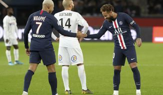 PSG's Kylian Mbappe, left, and Neymar celebrate after scoring their side's third goal during the League One soccer match between Paris Saint Germain and Amiens, at the Parc des Princes stadium in Paris, Saturday, Dec. 21, 2019. (AP Photo/Thibault Camus)