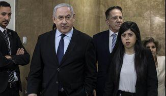 Israeli Prime Minister Benjamin Netanyahu arrives for the weekly Cabinet meeting at the Prime Minister's office in Jerusalem, Sunday, Dec. 22, 2019. (AP Photo/Tsafrir Abayov)