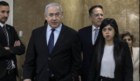 Israeli Prime Minister Benjamin Netanyahu arrives for the weekly Cabinet meeting at the Prime Minister's office in Jerusalem, Sunday, Dec. 22, 2019. (AP Photo/Tsafrir Abayov)