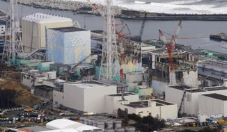 This March 11, 2012, file photo, shows three melted reactors, from left, Unit 1, Unit 2 and Unit 3 at Fukushima Dai-ichi nuclear power plant in Okuma, Fukushima prefecture, Japan. Japan revised a roadmap on Friday, Dec. 27, 2019, for the tsunami-wrecked Fukushima nuclear plant cleanup, further delaying the removal of thousands of spent fuel units that remain in cooling pools since the 2011 disaster. (Kyodo News via AP, File)