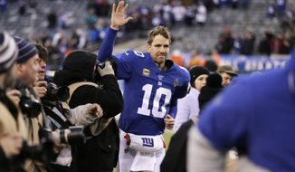 File-This Dec. 15, 2019, file photo shows New York Giants quarterback Eli Manning (10) leaving the field after defeating the Miami Dolphins in an NFL football game, in East Rutherford, N.J. The man who has been the face of the New York Giants since 2004 is probably going to make his final appearance this weekend. Manning's 16-year Giants' career that has included two Super Bowl titles likely will come to an end Sunday, Dec. 29, 2019, when New York tries to spoil the Philadelphia Eagles bid to win the NFC East. (AP Photo/Adam Hunger, File)