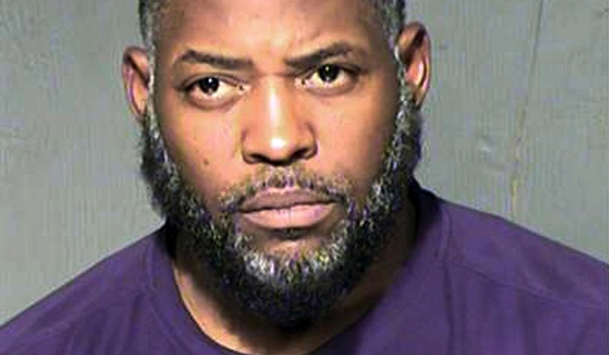 FILE - This undated file photo provided by the Maricopa County Sheriff's Department shows Abdul Malik Abdul Kareem. A federal judge refused to toss out the entire case against Kareem convicted of providing guns to and training two friends who attacked a Prophet Muhammad cartoon contest outside Dallas, but said this week he should be retried on a single count of transporting weapons across state lines. (Maricopa County Sheriff's Department via AP, File)