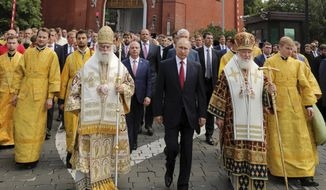 FILE In this file photo taken on Saturday, July 28, 2018, Russian Orthodox Church Patriarch Kirill, right, Russian President Vladimir Putin, center, and Eastern Orthodox Patriarch of Alexandria and all Africa Theodoros II, left, walk to attend a ceremony marking the 1,030th anniversary of the adoption of Christianity by Prince Vladimir, the leader of Kievan Rus, a loose federation of Slavic tribes that preceded the Russian state in Moscow, Russia. The Russian Orthodox Church has cut ties with the head of the Eastern Orthodox Patriarchate in Alexandria following his decision to recognize Ukraine's new independent Orthodox Church. (Mikhail Klimentyev, Sputnik, Kremlin Pool Photo via AP, File)