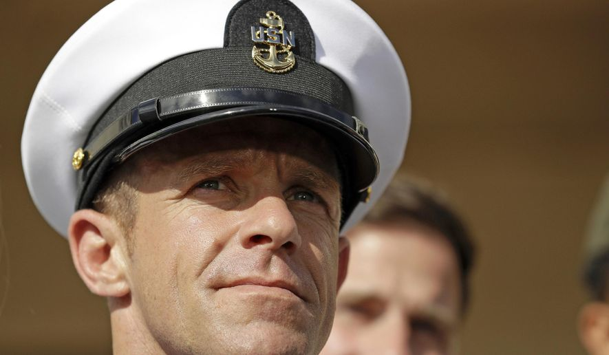In this July 2, 2019, file photo, Navy Special Operations Chief Edward Gallagher leaves a military court on Naval Base San Diego.  (AP Photo/Gregory Bull, File) **FILE**