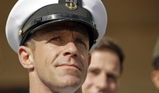 """FILE - In this July 2, 2019, file photo, Navy Special Operations Chief Edward Gallagher leaves a military court on Naval Base San Diego. Navy SEALs described their platoon leader, retired Special Operations Chief Gallagher, as """"evil,"""" """"toxic"""" and """"perfectly OK with killing anybody that was moving,"""" in video footage obtained by The New York Times. (AP Photo/Gregory Bull, File)"""