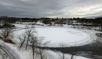FILE - In this Jan. 23, 2019 file photo, a naturally occurring, slowly spinning ice disk the width of a football field floats in the Presumpscot River in Westbrook, Maine. The story of the rotating frozen is among some of 2019's weirder stories in New England. (AP Photo/Robert F. Bukaty, File)