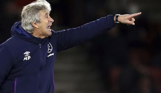 West Ham United manager Manuel Pellegrini gestures on the touchline during the game against Southampton, during their English Premier League soccer match at St Mary's Stadium in Southampton, England, Saturday Dec. 14, 2019. (Steven Paston/PA via AP)