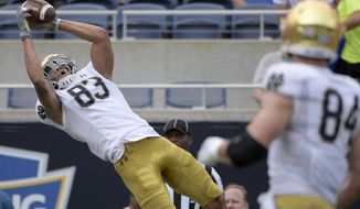 Notre Dame wide receiver Chase Claypool (83) catches a pass in the end zone for a 24-yard touchdown during the first half of the Camping World Bowl NCAA college football game against Iowa State Saturday, Dec. 28, 2019, in Orlando, Fla. (AP Photo/Phelan M. Ebenhack)